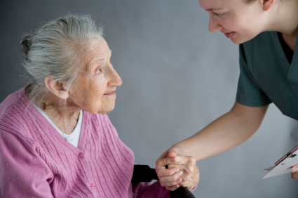 Social Worker helping an elderly lady